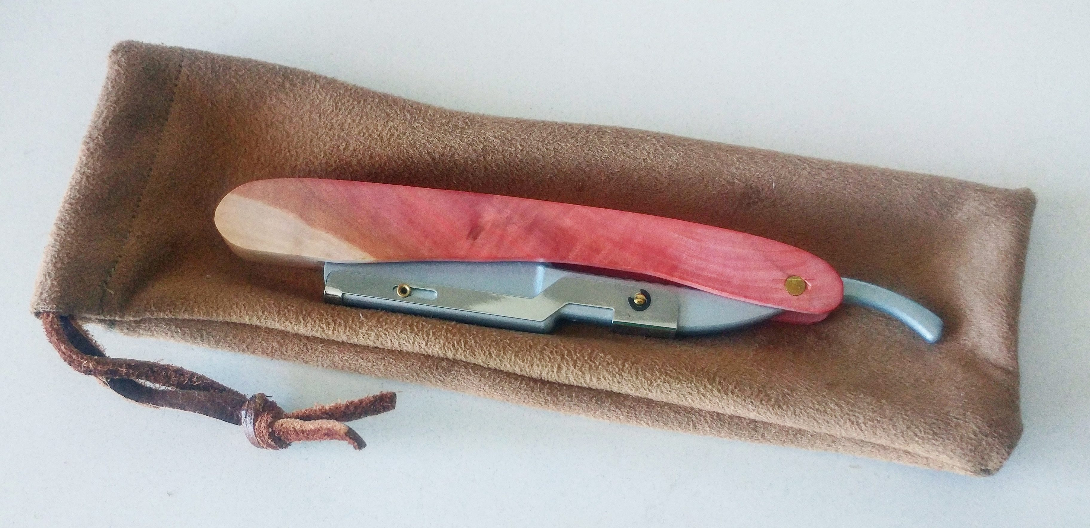 pink rosewood straight razor on sued bag