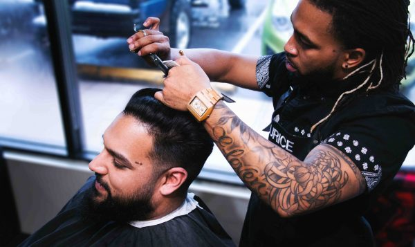 Maurice St. Rose cutting hair at Mocutz Barbershop in Victoria BC